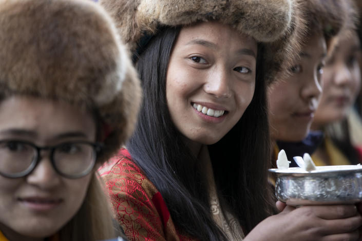 Friends and family members wait to receive the all-Nepalese mountaineering team that became the first to scale Mount K2 in winter as they arrive at Tribhuwan International airport in Kathmandu, Nepal, Tuesday, Jan. 26, 2021. (AP Photo/Niranjan Shrestha)