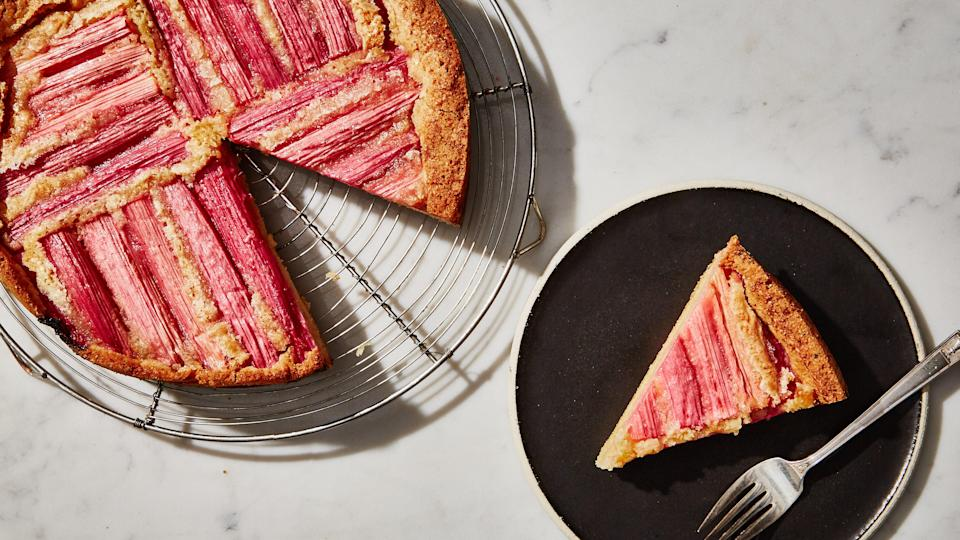 """This cake is designed to be mixed by hand. Using an electric mixer works more air into the eggs, which lightens the batter and makes it less dense, so the fruit is more prone to sinking. Also, make sure you leave the stalks whole, as chopped rhubarb is more likely to be swallowed up by the batter and sink to the bottom. <a href=""""https://www.bonappetit.com/recipe/rhubarb-custard-cake?mbid=synd_yahoo_rss"""" rel=""""nofollow noopener"""" target=""""_blank"""" data-ylk=""""slk:See recipe."""" class=""""link rapid-noclick-resp"""">See recipe.</a>"""