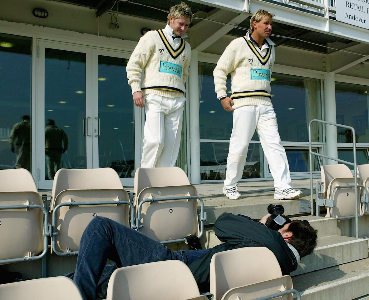 SOUTHAMPTON - APRIL 14:  Australians Shane Warne (R) and Michael Clarke pose for pictures at the Hampshire Cricket Club pre-season photocall at The Rosebowl on April 14, 2004 in Southampton, England.(Photo by Mike Hewitt/Getty Images)