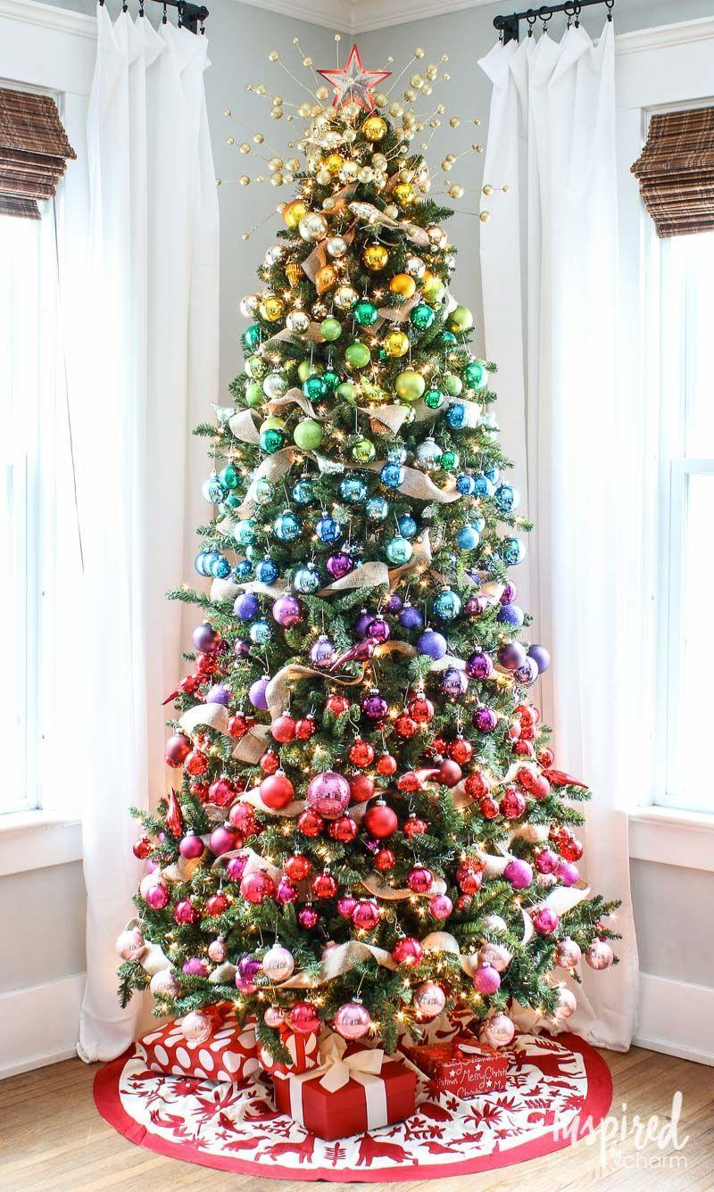 "<p>This gradient rainbow tree is anything but drab. Stray away from classic red and green accents and incorporate the entire rainbow. Start with pink and red on the bottom and end with glowing gold ornaments on top near the star.</p><p>See more at <a href=""https://inspiredbycharm.com/gradient-rainbow-christmas-tree/"" rel=""nofollow noopener"" target=""_blank"" data-ylk=""slk:Inspired By Charm"" class=""link rapid-noclick-resp"">Inspired By Charm</a>.</p><p><a class=""link rapid-noclick-resp"" href=""https://www.amazon.com/AMS-Christmas-Ornaments-Exquisite-Decorations/dp/B017NMAZHK/ref=sr_1_4?dchild=1&keywords=colorful+ornaments&qid=1596680312&s=home-garden&sr=1-4&tag=syn-yahoo-20&ascsubtag=%5Bartid%7C10057.g.505%5Bsrc%7Cyahoo-us"" rel=""nofollow noopener"" target=""_blank"" data-ylk=""slk:SHOP ORNAMENTS"">SHOP ORNAMENTS</a> <em><strong>Colorful Ornaments, $13</strong></em><br></p>"