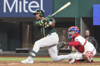Oakland Athletics shortstop Elvis Andrus singles in the fifth inning against the Texas Rangers in a baseball game Tuesday, June 22, 2021, in Arlington, Texas. (AP Photo/Louis DeLuca)