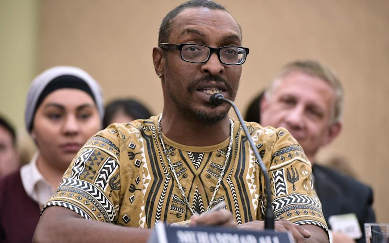 Muhammad Ali Jr, the son and namesake of the late boxing great, speaks in Washington about the consequences of the travel ban - AFP or licensors