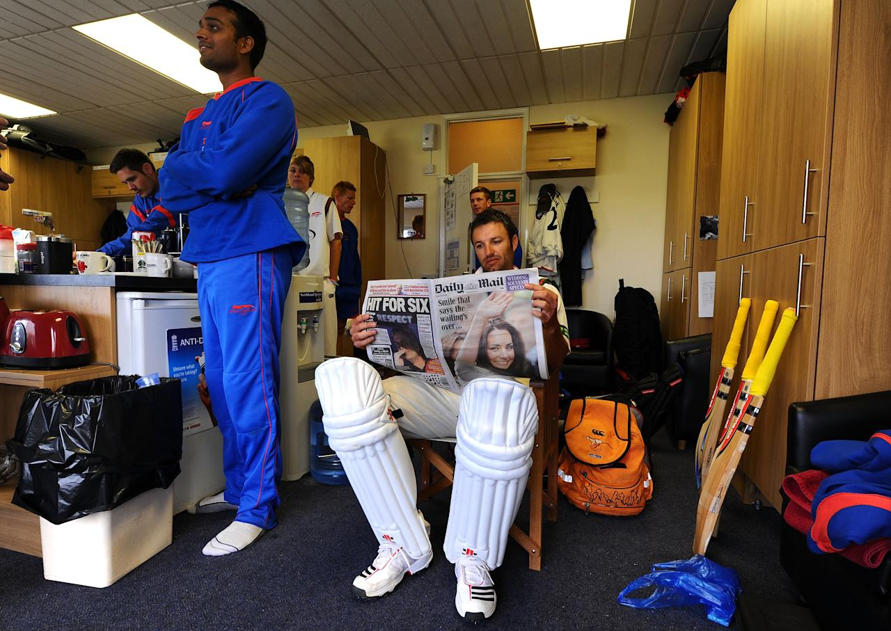 LEICESTER, ENGLAND - APRIL 29:  Leicestershire batsman Jacques Du Toit reads about the royal wedding whilst waiting to bat whilst his Leicestershire teammates watch the Royal Wedding in the dressing room during day three of the Division Two LV County Championship match beteen Leicestershire and Derbyshire at Grace Road on April 29, 2011 in Leicester, England.  (Photo by Stu Forster/Getty Images)