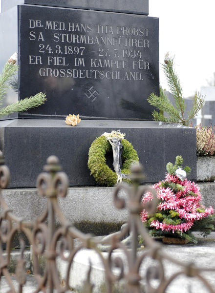 """This picture taken Tuesday, Jan. 21, 2014 shows a marble tombstone which is adorned by a swastika and the inscription """"He died in the struggle for a Great Germany"""" at the central cemetery in Graz, Austria. Austrian law bans such symbols, and those displaying them face criminal charges and potential prison terms. Yet the emblems reflecting this country's darkest chapter in history endure here, and officials here appear either unable or unwilling to do away with them. (AP Photo/Hans Punz)"""