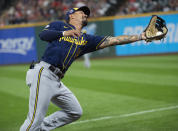 Milwaukee Brewers' Jace Peterson catches a pop foul by Cleveland Indians' Austin Hedges during the ninth inning of a baseball game in Cleveland, Saturday, Sept. 11, 2021. The Brewers won 3-0. (AP Photo/Phil Long)