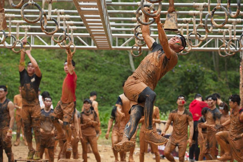 SHENZHEN, CHINA - MARCH 24: Participants compete in the Spartan Race Shenzhen Sprint 2018 at Mission Hills Sports & Eco Park on March 24, 2018 in Shenzhen, Guangdong Province of China. (Photo by Visual China Group via Getty Images/Visual China Group via Getty Images)