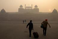FILE PHOTO: People arrive to visit the Red Fort on a smoggy morning in the old quarters of Delhi