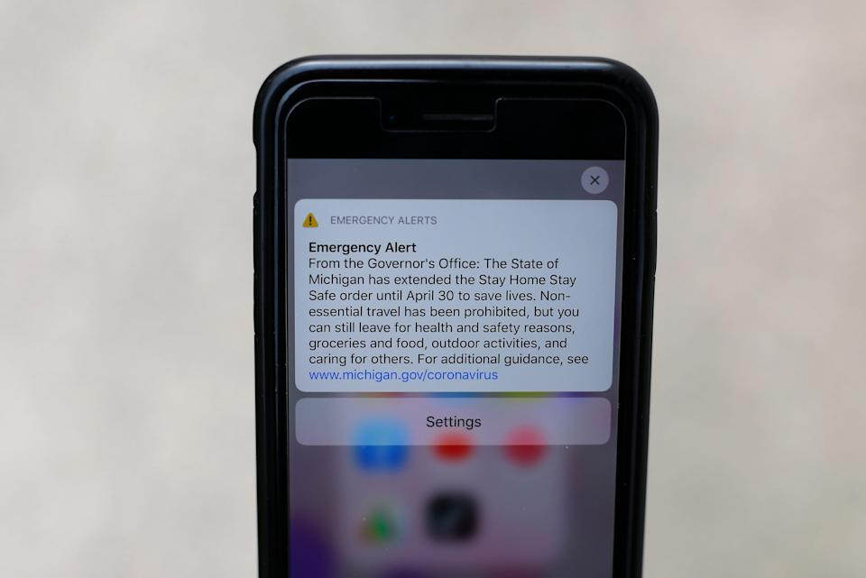 An emergency alert from Michigan's governor appears on a cellphone April 9, 2020.