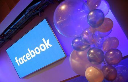 FILE PHOTO: Balloons are seen in front of a logo at Facebook's headquarters in London