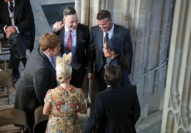 David and Victoria Beckham (right) talk with Sir Elton John and David Furnish (left) and Sofia Wellesley and James Blunt (foreground) at Meghan and Harry's wedding in May 2018 [Photo: Getty]