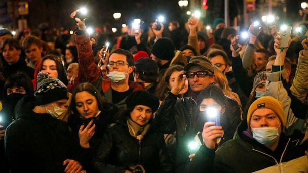 PHOTO: People shine the lights of their mobile phones during the opposition rally in support of jailed opposition leader Alexei Navalny in Moscow, Russia, April 21, 2021. (Alexander Zemlianichenko/AP)