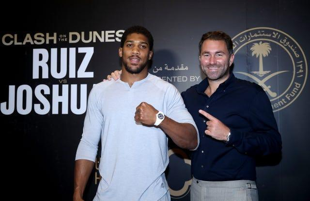 Anthony Joshua, left, is promoted by Eddie Hearn (Nick Potts/PA)