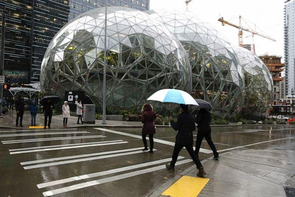 PHOTO: People walk past the Amazon Spheres, in Seattle, on Jan. 29, 2018l. (AFP via Getty Images, FILE)