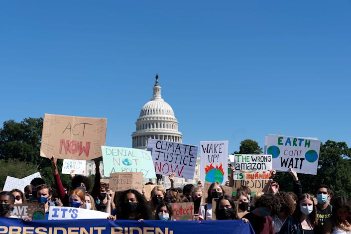 Environmental activists rally on Capitol Hill for climate change policies on Sept. 24, 2021.