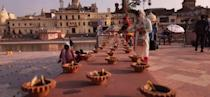 AYODHYA, INDIA - AUGUST 4: Earthen lamps laid out as part of decorations on the eve of the Ram Temple foundation laying ceremony on August 4, 2020 in Ayodhya, India. Prime Minister Narendra Modi will on Wednesday attend a public function on laying of the foundation stone of 'Shree Ram Janmabhoomi Mandir' at Ayodhya. Ram Janmabhoomi Teerth Kshetra, the trust set up for the construction and management of Ram temple, has invited 175 eminent guests for the foundation stone-laying ceremony after personally discussing with BJP veterans L K Advani and Murli Manohar Joshi, lawyer K Parasaran and other dignitaries. (Photo by Deepak Gupta/Hindustan Times via Getty Images)