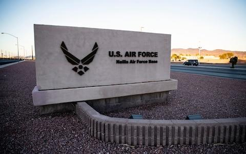 A sign indicates the entrance of the Nellis Air Force Base in Las Vegas, Nevada - Credit: Rex
