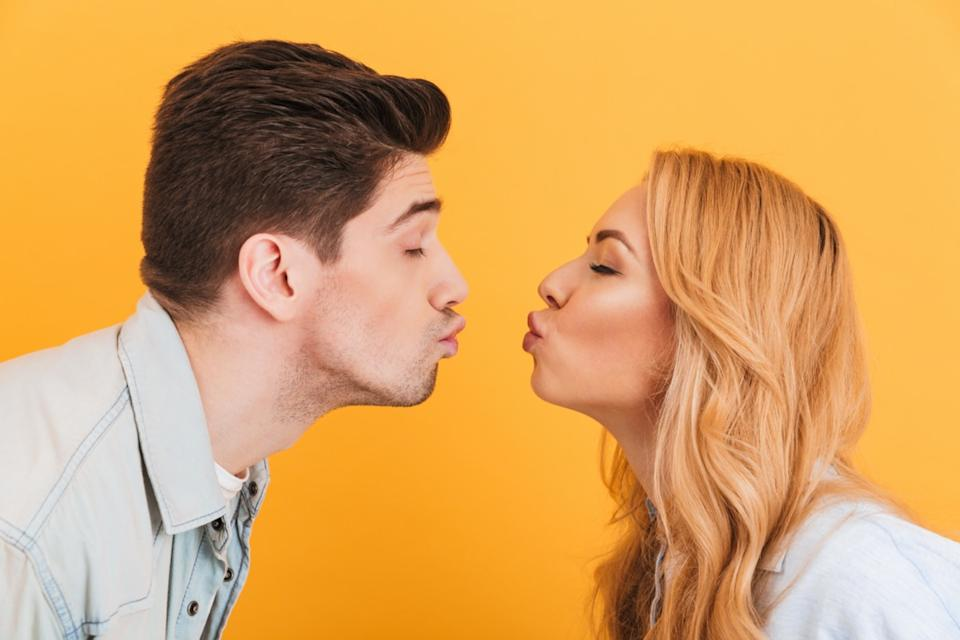 Young man and woman about to kiss