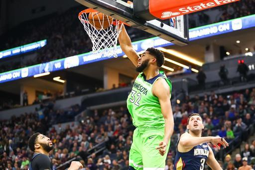 MINNEAPOLIS, MN - JANUARY 12: Karl-Anthony Towns #32 of the Minnesota Timberwolves dunks the ball against the New Orleans Pelicans in the fourth quarter at Target Center on January 12, 2019 in Minneapolis, Minnesota. The Minnesota Timberwolves defeated the New Orleans Pelicans 110-106. (Photo by David Berding/Getty Images)