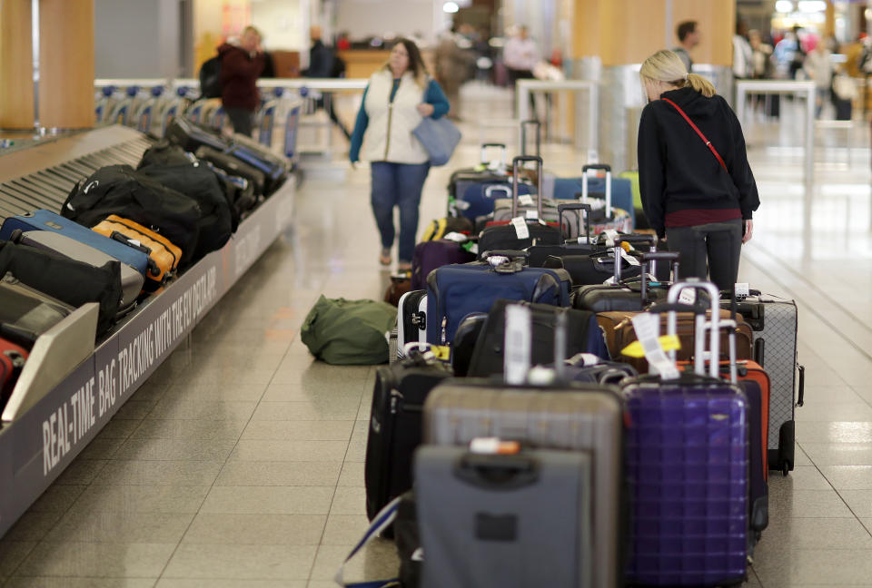 Unclaimed bags sit in baggage claim at Hartsfield-Jackson Atlanta International Airport in Atlanta, Monday, Dec. 18, 2017. While power was restored to the world's busiest airport early Monday, the travel woes will linger for days for the thousands of people stranded at Hartsfield-Jackson Atlanta International, where more than 1,000 flights were grounded just days before the start of the Christmas travel rush. (AP Photo/David Goldman)