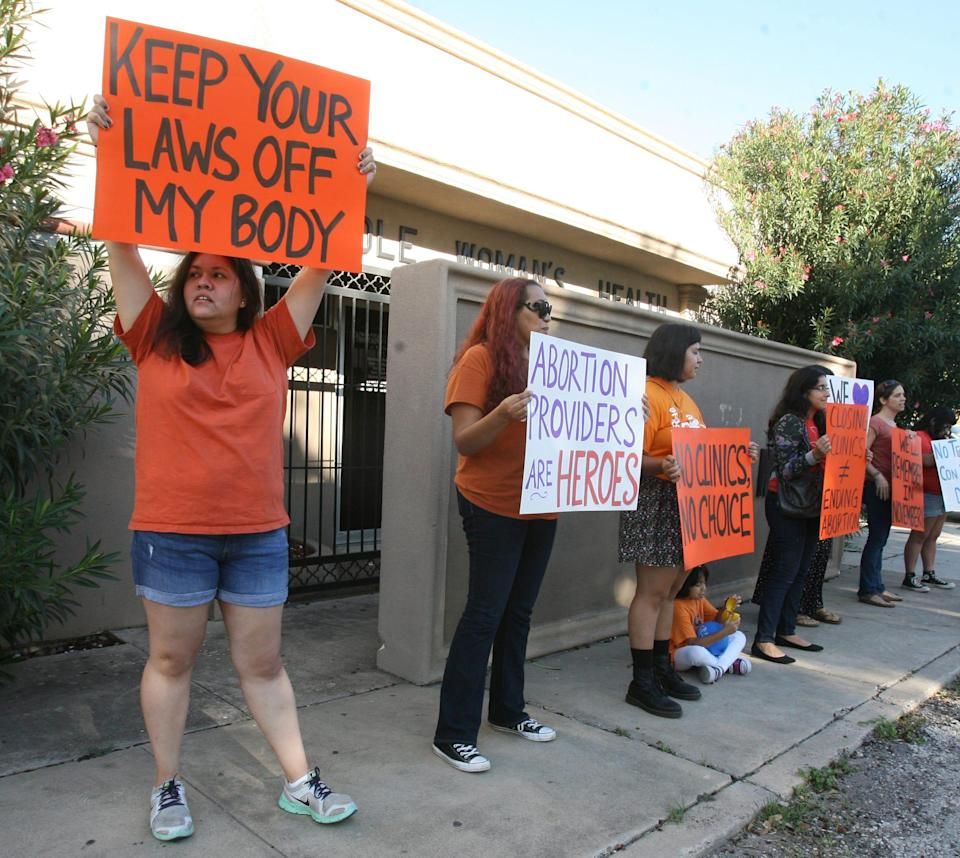 People demonstrate in front of a women's health clinic Oct. 4 in McAllen, Texas.