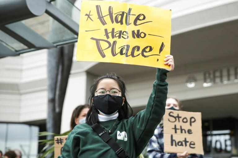 A University of Washington student takes part in the We Are Not Silent rally organized by the Asian American Pacific Islander (AAPI) Coalition Against Hate and Bias in Bellevue, Washington