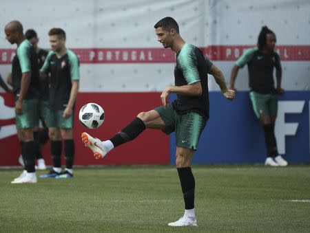 Soccer Football - World Cup - Portugal Training - Kratovo, Moscow Region, Russia - June 24, 2018. Cristiano Ronaldo attends a training session. REUTERS/Albert Gea