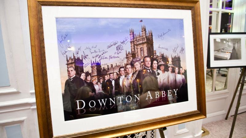 A signed Downton Abbey poster, the only better gift for a Downton Abbey fan than a new movie.