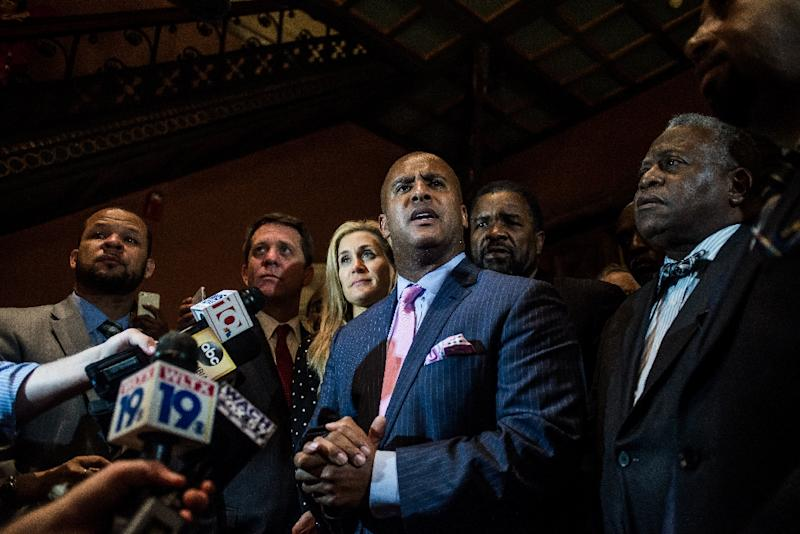 State Rep. Todd Rutherford and fellow lawmakers talk to the media at the South Carolina state house on July 9, 2015 in Columbia (AFP Photo/Sean Rayford)