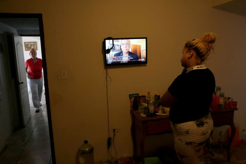 A cuban migrant watches television at her home after media announced that Democratic U.S. presidential nominee Joe Biden has won the 2020 U.S. presidential election in Ciudad Juarez
