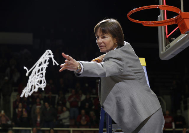 Stanford coach Tara VanDerveer tosses the net to her team after Stanford's 74-65 win over North Carolina in a regional final at the NCAA women's college basketball tournament in Stanford, Calif., Tuesday, April 1, 2014. (AP Photo/Marcio Jose Sanchez)