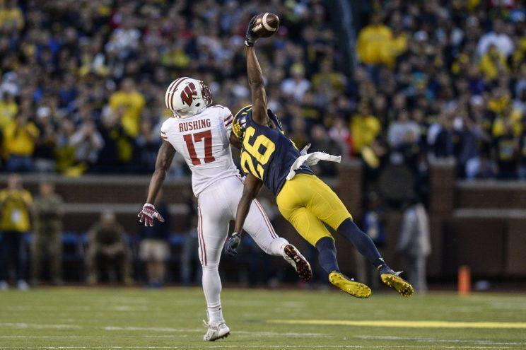 Michigan's Jourdan Lewis stretches for the game-winning interception on Saturday. (AP)