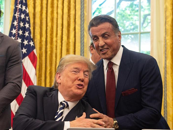 Sylvester Stallone pictured with Donald Trump during a visit to the White House in 2018 (AFP via Getty Images)