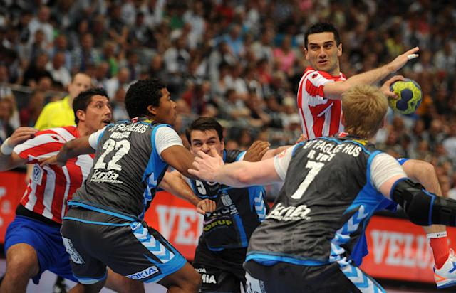 Madrid's Kiril Lazarov (R, top) vies with players of Copenhagen during the Handball Champions League EHF Final Four semi final match BM Atletico Madrid vs AG Kobenhavn on May 26, 2012 in Cologne, western Germany. AFP PHOTO JONAS GUETTLER GERMANY OUTJONAS GUETTLER/AFP/GettyImages
