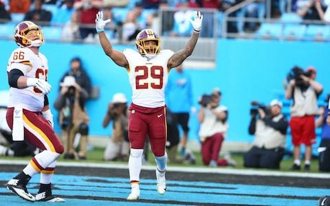 Washington Redskins running back Derrius Guice (29) celebrates a touchdown during the third quarter against the Carolina Panthers at Bank of America Stadium - Credit: USA Today