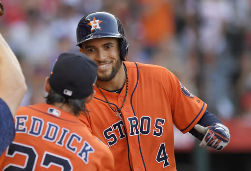 Houston Astros' George Springer, right, is congratulated by Josh Reddick after hitting a grand slam during the sixth inning of a baseball game against the Los Angeles Angels, Saturday, July 21, 2018, in Anaheim, Calif. Reddick had a solo home run earlier in the inning. (AP Photo/Mark J. Terrill)