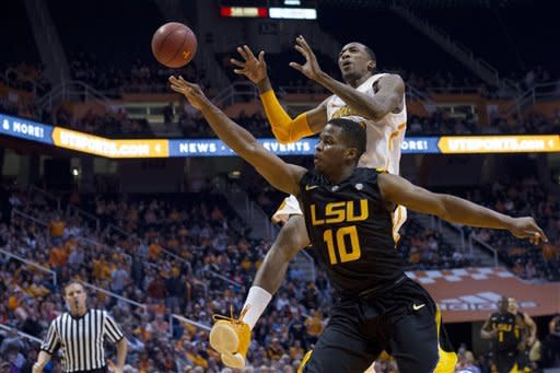 LSU's Andre Stringer (10 knocks the ball away from Tennessee's Jordan McRae during the first half of an NCAA college basketball game Tuesday, Feb. 19, 2013, in Knoxville, Tenn. (AP Photo/The Knoxville News Sentinel, Saul Young)