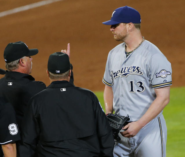 Milwaukee Brewers relief pitcher Will Smith (13) is ejected during the seventh inning of a baseball game against the Atlanta Braves for allegedly using pine tar, Thursday, May 21, 2015, in Atlanta. (AP Photo/John Bazemore)
