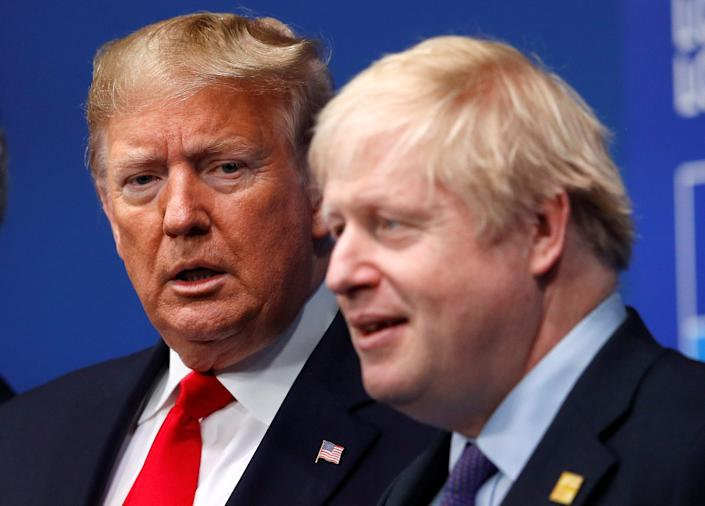 FILE PHOTO: Britain's Prime Minister Boris Johnson welcomes U.S. President Donald Trump at the NATO leaders summit in Watford, Britain December 4, 2019. REUTERS/Peter Nicholls/Pool