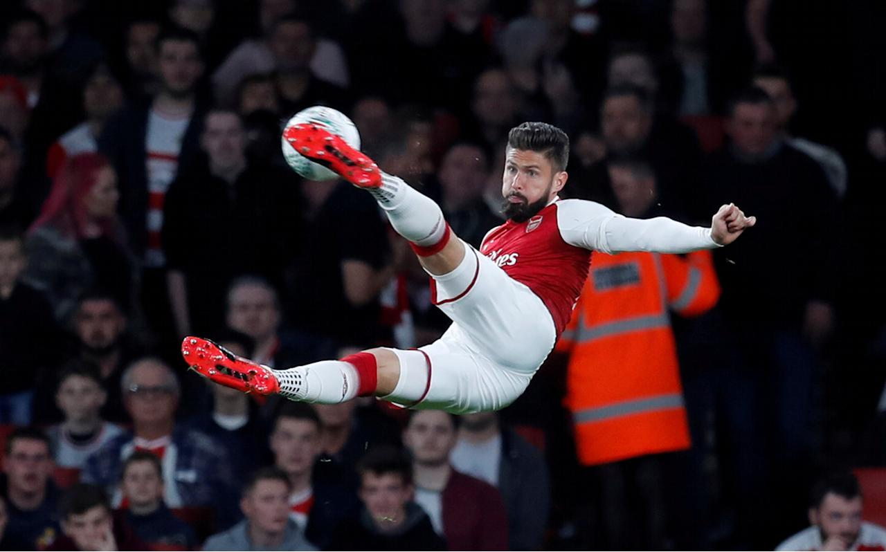 """Soccer Football - Carabao Cup Third Round - Arsenal vs Doncaster Rovers - Emirates Stadium, London, Britain - September 20, 2017   Arsenal's Olivier Giroud in action   REUTERS/Eddie Keogh    EDITORIAL USE ONLY. No use with unauthorized audio, video, data, fixture lists, club/league logos or """"live"""" services. Online in-match use limited to 75 images, no video emulation. No use in betting, games or single club/league/player publications. Please contact your account representative for further details.     TPX IMAGES OF THE DAY"""