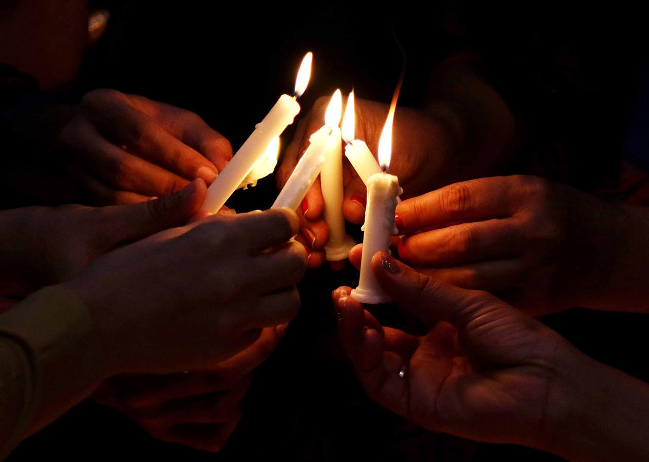 <p>Transgender women hold candles during the World AIDS day in Karachi, Pakistan on December 1, 2016. The World AIDS Day, observed December 1, each year, is dedicated to raising awareness against the spread of AIDS and HIV infections. (Shahzaid Akber/EPA) </p>