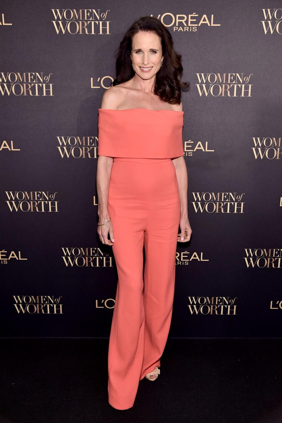 <p>Andie McDowell showed off her sartorial prowess in an on-trend off-shoulder jumpsuit. <i>[Photo: Getty]</i> </p>