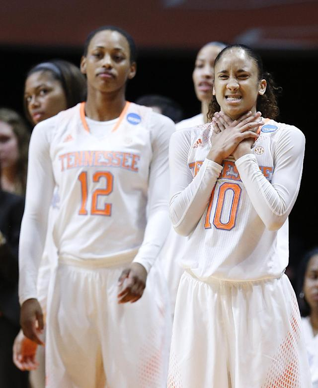 Tennessee's Meighan Simmons (10) and Bashaara Graves (12) watch the action in the second half of an NCAA women's college basketball second-round tournament game against St. John's Monday, March 24, 2014, in Knoxville, Tenn. (AP Photo/John Bazemore)