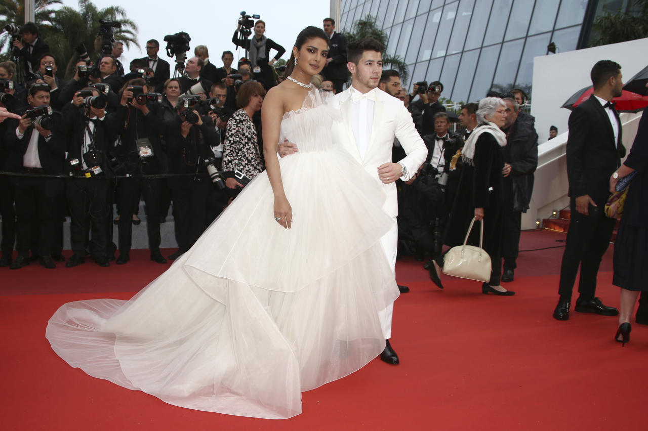 Actress Priyanka Chopra, left, and Nick Jonas pose for photographers upon arrival at the premiere of the film 'The Best Years of a Life' at the 72nd international film festival, Cannes, southern France, Saturday, May 18, 2019. (Photo by Joel C Ryan/Invision/AP)