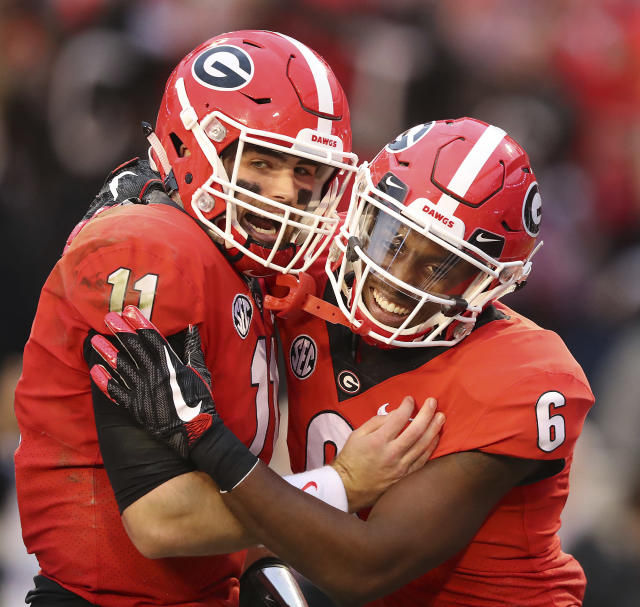 "Georgia quarterback <a class=""link rapid-noclick-resp"" href=""/ncaaf/players/275086/"" data-ylk=""slk:Jake Fromm"">Jake Fromm</a> celebrates his touchdown throw with wide receiver Javon Wims, who caught it, during the first half of a NCAA college football game against Kentucky, Saturday, Nov. 18, 2017, in Athens, Ga. (Curtis Compton/Atlanta Journal-Constitution via AP)"