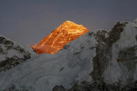 """FILE - In this Nov. 12, 2015, file photo, Mt. Everest is seen from the way to Kalapatthar in Nepal. China will draw a """"separation line"""" atop Mount Everest to prevent the coronavirus from being spread by climbers ascending Nepal's side of the mountain, Chinese state media reported Monday. (AP Photo/Tashi Sherpa, File)"""