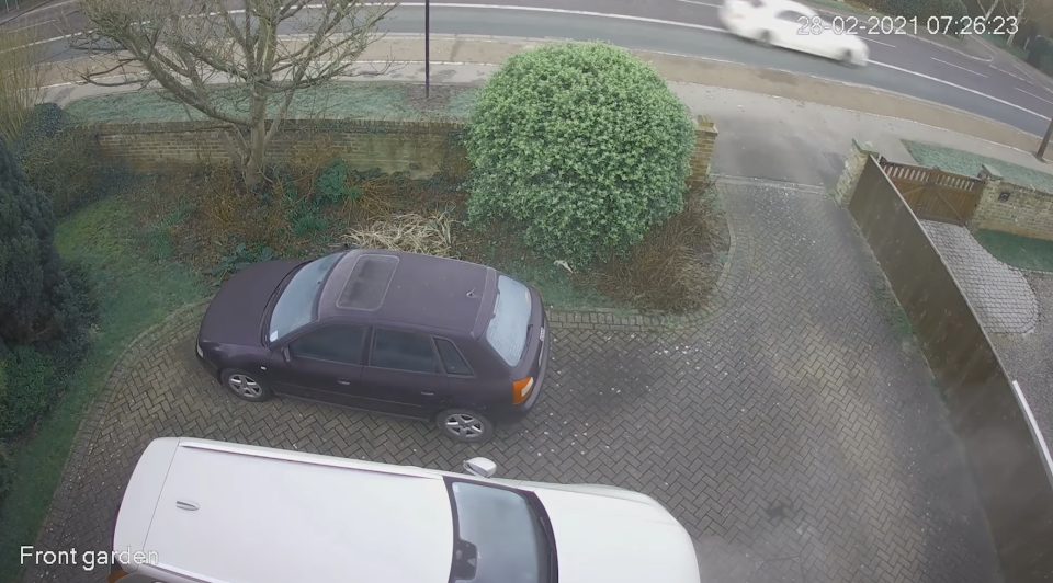 A Mercedes is seen speeding on a road in CCTV footage.