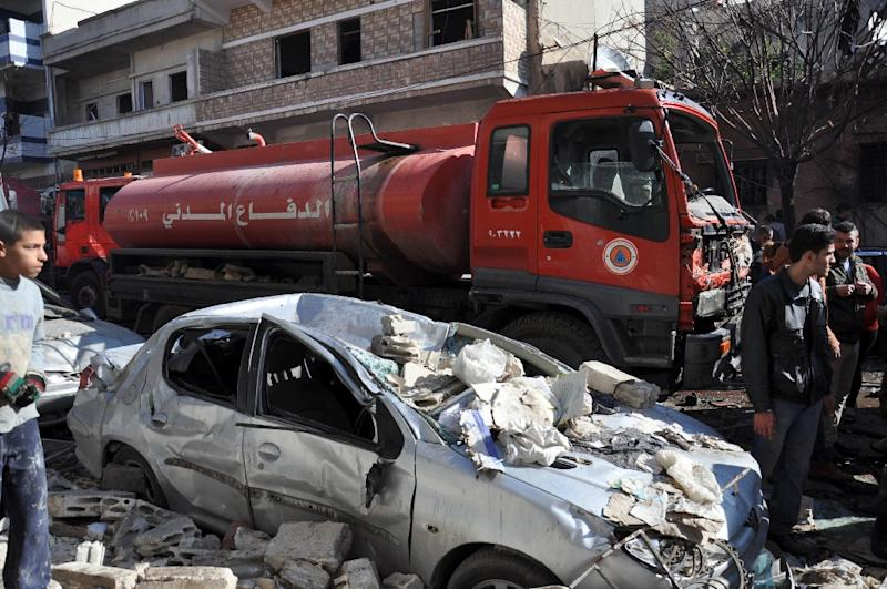 A firefighter truck at the scene of the car bomb explosion in al-Zahra neighborhood in Homs on December 12, 2015 (AFP Photo/)