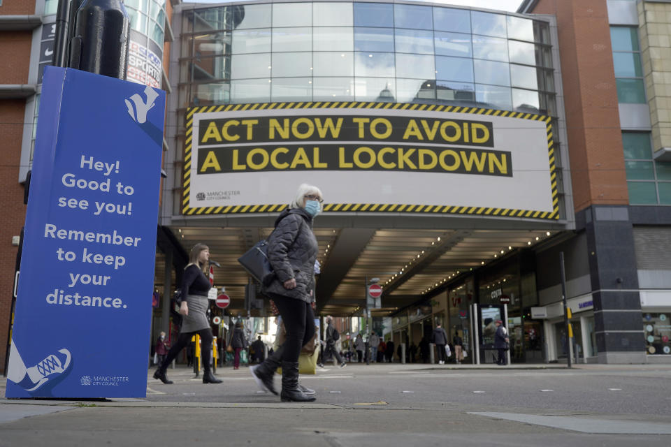 MANCHESTER, ENGLAND - OCTOBER 07: A pandemic lockdown warning sign is displayed to shoppers on October 07, 2020 in Manchester, England. Manchester now has the highest coronavirus (Covid-19) infection rate in the country, with nearly 600 cases per 100,000 people. Manchester University and Manchester Metropolitan University have also now moved all lectures online with many students quarantined in their residential halls. (Photo by Christopher Furlong/Getty Images)