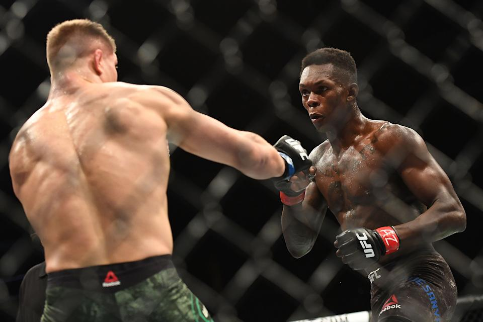 GLENDALE, AZ - APRIL 14: (R-L) Israel Adesanya of Nigeria in action during the middleweight fight against Marvin Vettori of Italy during the UFC Fight Night at Gila River Arena on April 14, 2018 in Glendale, Arizona.  (Photo by Jennifer Stewart/Getty Images)