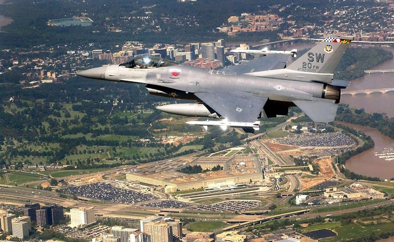 This undated photo provided by the U.S. Air Force shows an F-16 Fighting Falcon flying over the Pentagon as part of Operation Noble Eagle recently.  The aircraft is assigned to the 20th Fighter Wing at Shaw Air Force Base, S.C.  Fewer pilots are breaking airspace rules, despite the recent flurry over Camp David. (AP Photo/U.S. Air Force, Staff Sgt. Aaron D.  Allmon II)